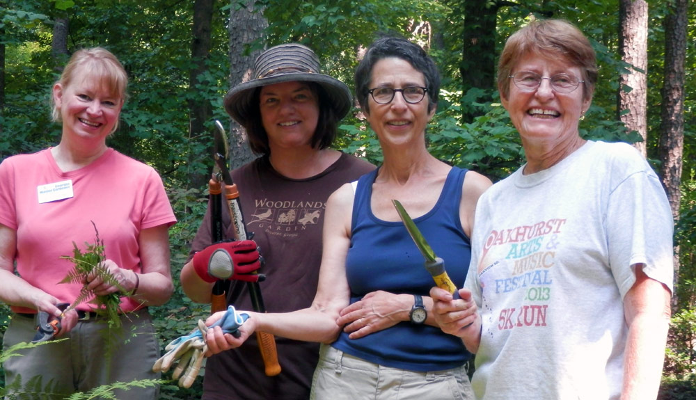 Garden Manager Ruby Bock, second from right, is pictured with some dedicated Woodlands volunteers.